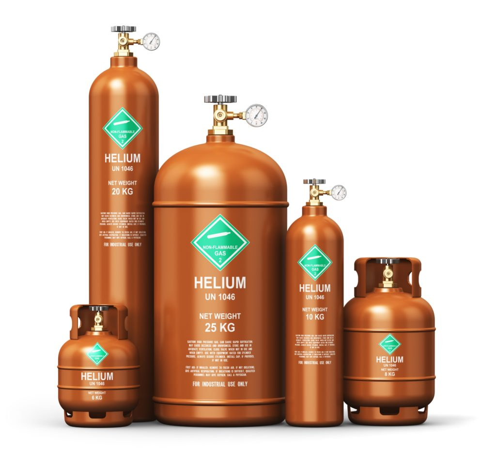 Five industrial helium canisters of varying sizes