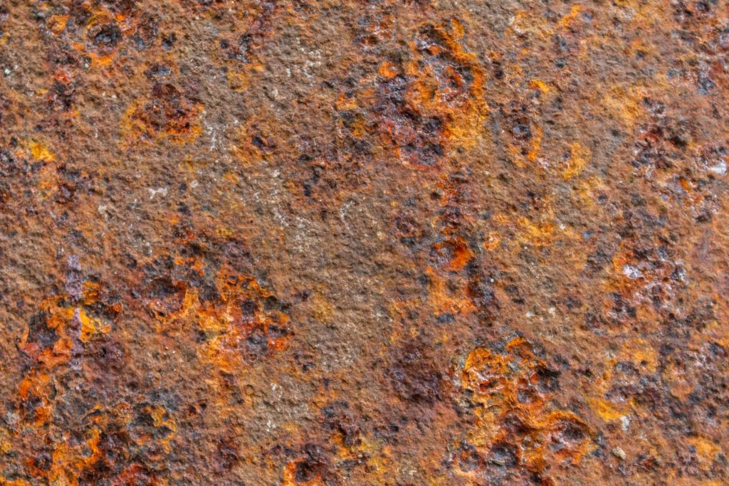 Close up image of rusty metal structure, corrosion