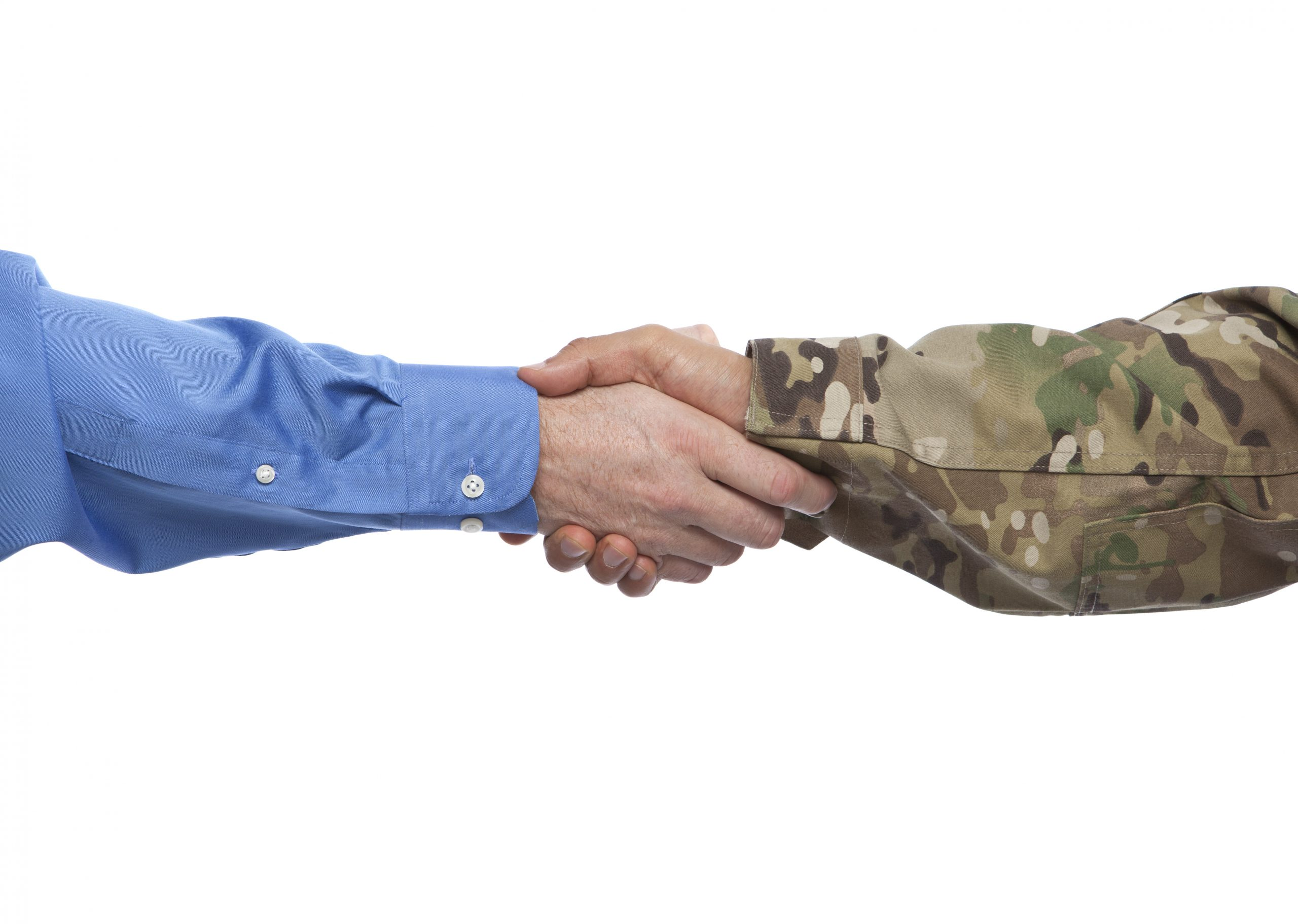 US Army solder shaking civilian business owner's hand