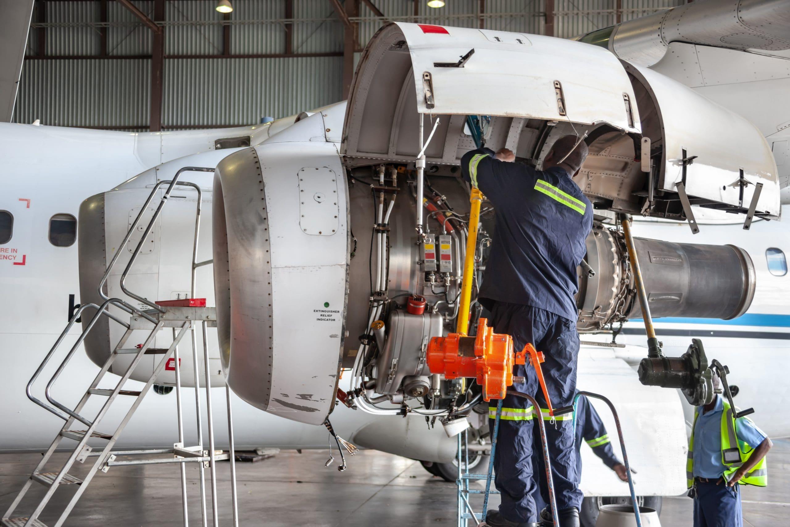 Aerospace mechanics working on repairs