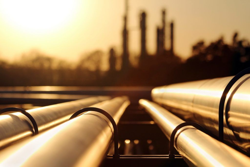 pipelines with the sun reflecting off of them