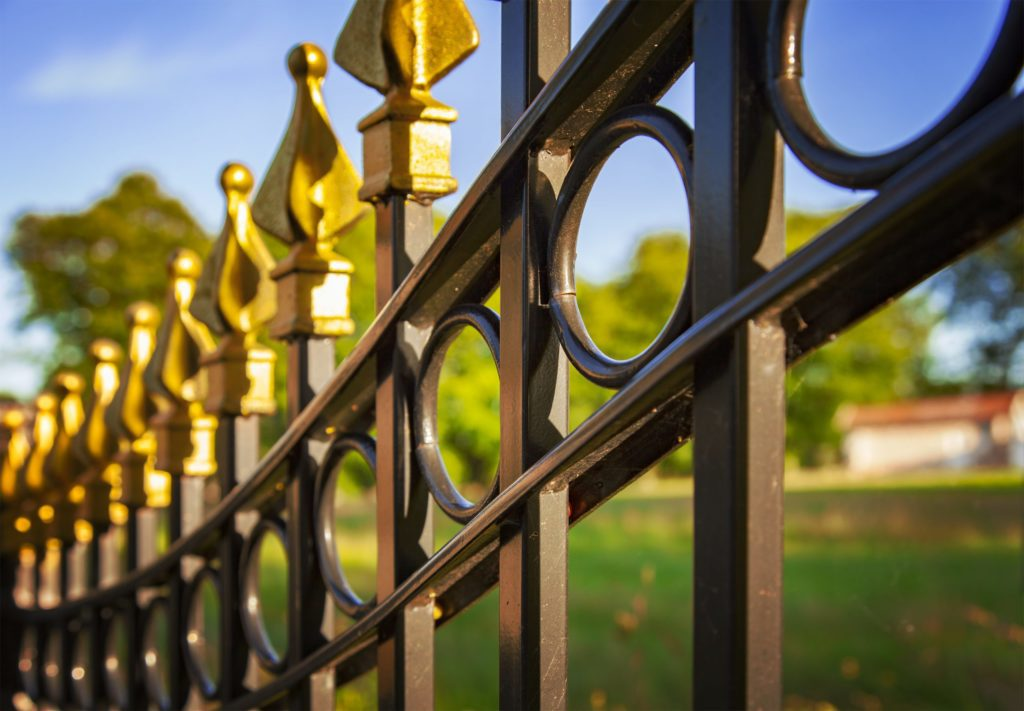 wrought iron fence with decorative golden colored tips